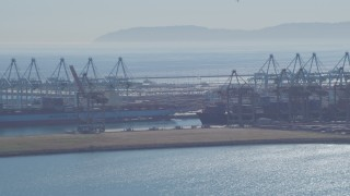 DCA06_042 - 4K stock footage aerial video flyby cargo ships, containers and cranes, Port of Los Angeles, San Pedro, California