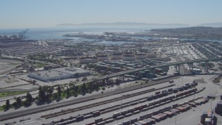 DCA06_043 - 4K stock footage aerial video flyby cargo containers, reveal bridge at Port of Los Angeles, San Pedro, California