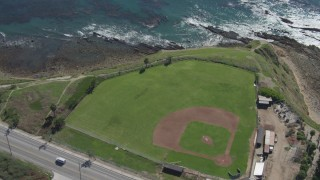 DCA06_049 - 4K stock footage aerial video flyby coastal road revealing Mary Star Fromhold Baseball Field, San Pedro, California