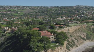 DCA06_057 - 4K stock footage aerial video orbit a mansion on a cliff, overlooking ocean in Palos Verdes Estates, California