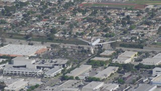 DCA06_061 - 4K stock footage aerial video of a cargo jet coming in for landing, LAX (Los Angeles International Airport), Los Angeles, California