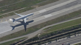 DCA06_062 - 4K stock footage aerial video of a cargo jet landing at LAX (Los Angeles International Airport), Los Angeles, California