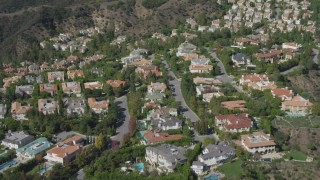 DCA06_071 - 4K stock footage aerial video of approach and orbit mansions in Bel Air, California