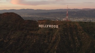 DCA07_002 - 4K stock footage aerial video of flying by the Hollywood Sign, Los Angeles, California, sunset