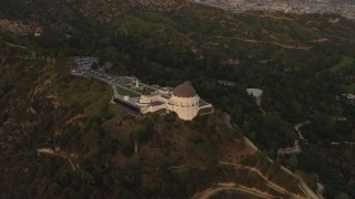 DCA07_003 - 4K stock footage aerial video of orbiting the Griffith Observatory, Los Angeles, California, sunset