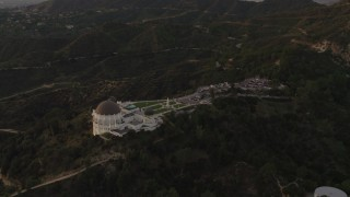 DCA07_004 - 4K stock footage aerial video of orbiting around the south side of the Griffith Observatory, Los Angeles, California, sunset