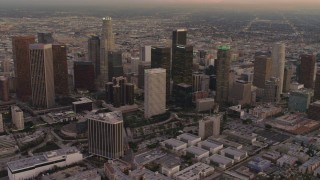 DCA07_006 - 4K stock footage aerial video of approaching Downtown Los Angeles skyscrapers, Los Angeles, California, sunset