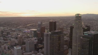 DCA07_008 - 4K stock footage aerial video of flying by Downtown Los Angeles skyscrapers, California, sunset