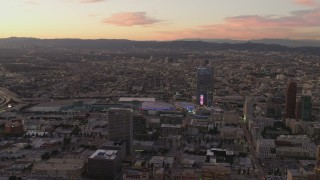 DCA07_009 - 4K stock footage aerial video of flying by Staples Center, The Ritz-Carlton, Downtown buildings, Los Angeles, California, sunset