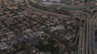 DCA07_014 - 4K stock footage aerial video of flying by Highway 110, over buildings, Downtown, Los Angeles, California, twilight