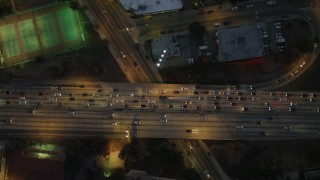 DCA07_031 - 4K stock footage aerial video of a bird's eye view flying over Highway 101, Echo Park, California, night