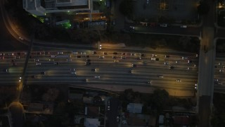 DCA07_032 - 4K stock footage aerial video of bird's eye view flying over Highway 101, heavy traffic, Echo Park, California, night
