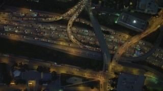 DCA07_038 - 4K stock footage aerial video a bird's eye flying over Highway 110, reveal Westin Bonaventure Hotel, Downtown Los Angeles, California, night