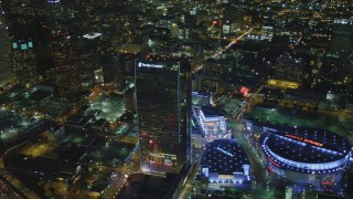 DCA07_058 - 4K stock footage aerial video of The Ritz-Carlton, Nokia, Theater, Staples Center, reveal skyscrapers, Los Angeles, California, night