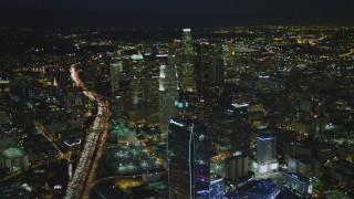 DCA07_059 - 4K stock footage aerial video of The Ritz-Carlton, skyscrapers, Highway 110, Los Angeles, California, night