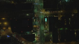 DCA07_068 - 4K stock footage aerial video of following Wilshire Blvd from Irolo Street to South Harvard Blvd, Koreatown, Los Angeles, California, night