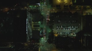DCA07_069 - 4K stock footage aerial video of following Wilshire Blvd from South Harvard Street to South Oxford Avenue, Koreatown, Los Angeles, California, night