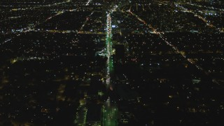 DCA07_073 - 4K stock footage aerial video of following Wilshire Blvd, reveal Century City, Mid-Wilshire, Los Angeles, California, night