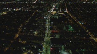 DCA07_075 - 4K stock footage aerial video of following Wilshire Blvd through Mid-Wilshire, Los Angeles, California, night