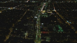 DCA07_076 - 4K stock footage aerial video of following Wilshire Blvd through Mid-Wilshire, Los Angeles, California, night