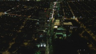 DCA07_077 - 4K stock footage aerial video of following Wilshire Blvd through Mid-Wilshire, Los Angeles, California, night