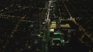 DCA07_078 - 4K stock footage aerial video of following Wilshire Blvd through Mid-Wilshire, Los Angeles, California, night