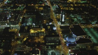 DCA07_084 - 4K stock footage aerial video of following Sunset Blvd past Cinerama Dome, to North Gower Street; Hollywood, California, night