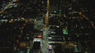 DCA07_090 - 4K stock footage aerial video of Hollywood Blvd, past Hollywood and Highland, Roosevelt Hotel, Hollywood, California, night