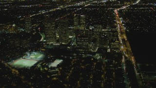 DCA07_097 - 4K stock footage aerial video of approaching skyscrapers, Century City, California, night