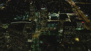 DCA07_098 - 4K stock footage aerial video of approaching skyscrapers in Century City, California, night