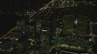 DCA07_100 - 4K stock footage aerial video of flying by skyscrapers, Century City, California, night