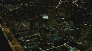 DCA07_101 - 4K stock footage aerial video of flying away from skyscrapers, Century City, California, night