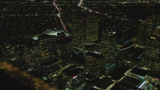 DCA07_102 - 4K stock footage aerial video of flying by skyscrapers, Century City, California, night