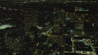 DCA07_103 - 4K stock footage aerial video of flying by skyscrapers, revealing Avenue of the Stars, Century City, California, night