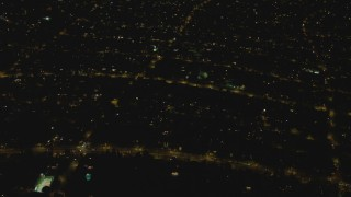DCA07_104 - 4K stock footage aerial video of approaching a residential neighborhood, Beverly Hills, California, night