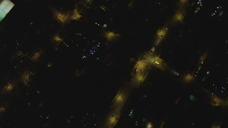 DCA07_105 - 4K stock footage aerial video of a bird's eye view of residential neighborhoods, Beverly Hills, California, night