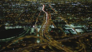 DCA07_110 - 4K stock footage aerial video of approaching Interstate 110 and Interstate 10 interchange, Downtown, Los Angeles, California, night