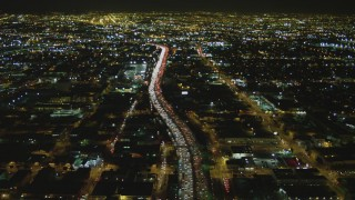 DCA07_112 - 4K stock footage aerial video fly over Interstate 10, Downtown, Los Angeles, California, night