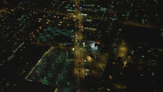 DCA07_116 - 4K stock footage aerial video of flying over Atlantic Avenue, Bell, California, night