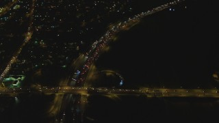 DCA07_117 - 4K stock footage aerial video of flying away from Interstate 710, Lynwood, California, night