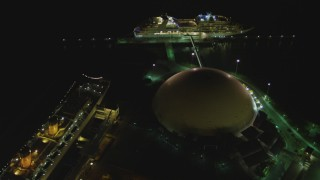 DCA07_127 - 4K stock footage aerial video of RMS Queen Mary, Carnival Cruise lines building, cruise ship, Long Beach, California, night