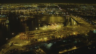 DCA07_131 - 4K stock footage aerial video of cargo containers, cranes, Port of Long Beach, California, night
