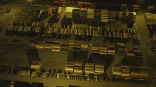 DCA07_138 - 4K stock footage aerial video of a bird's eye view flying over cargo containers, Port of Long Beach, California, night