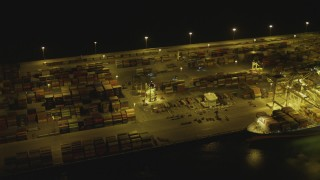 DCA07_143 - 4K stock footage aerial video of cargo containers at Port of Long Beach, California, night