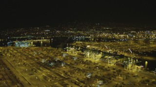 DCA07_151 - 4K stock footage aerial video pan across cargo containers and cranes, Port of Los Angeles, San Pedro, California, night