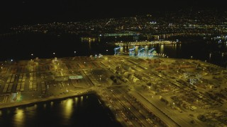 DCA07_152 - 4K stock footage aerial video of panning across cargo containers, Port of Los Angeles, San Pedro, California, night