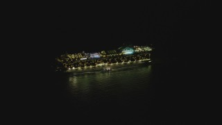 DCA07_154 - 4K stock footage aerial video of orbiting a cruise ship sailing near the Port of Los Angeles, San Pedro, California, night