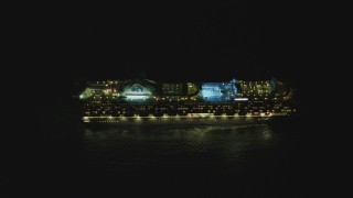 DCA07_156 - 4K stock footage aerial video of a cruise ship sailing near the Port of Los Angeles, San Pedro, California, night
