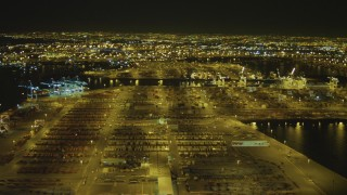 DCA07_158 - 4K stock footage aerial video of panning across the Port of Los Angeles, San Pedro, California, night