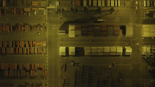 DCA07_161 - 4K stock footage aerial video of bird's eye view of shipping containers, trucks, Port of Los Angeles, San Pedro, California, night